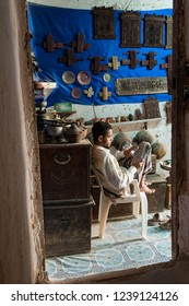 Shibam, Yemen - May 8, 2007: A man waits for customers in his antique shop.