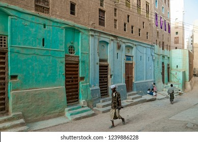 Shibam, Yemen - May 8, 2007: A man in traditional clothes walks in a street. The old town of Shibam is a UNESCO World Heritage City.