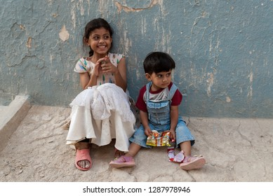 Shibam, Yemen - May 8, 2007: A girl and her little brother sit on the street outside their house. Children in Yemen are socially valued.