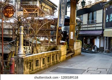 Shibu Onsen, Nagano, Japan - February 08,2016, Historic traditional ryokan and onsen hot spring resort  with public baths  near ski resort Shiga Kogen and snow monkey park