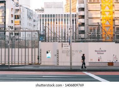 Shibuya Harajuku, Tokyo / Japan - January - 1st - 2019: construction site and street graffiti close to JR harajuku - shibuya train stations in new year day