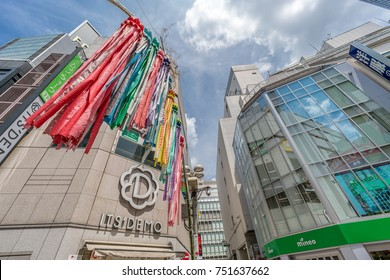 Shibuya - Tokyo, August 07, 2017 : Colorful decoration for Tanabata Festival (Festival of Stars) and billboards in the streets of Shibuya district durng daytime.