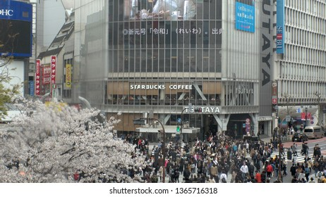 """SHIBUYA,  TOKYO,  JAPAN - APRIL 1st 2019 : """"REIWA"""" becomes the new name, for a new era, under a new Emperor.  Breaking news reporting new era on big screen at Shibuya crossing."""