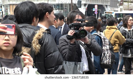 "SHIBUYA,  TOKYO,  JAPAN - APRIL 1st 2019 : ""REIWA"" becomes the new name, for a new era, under a new Emperor.  REPORTER and TV CREW shooting at SHIBUYA crossing area."