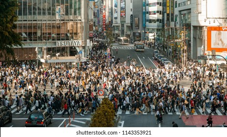 SHIBUYA, TOKYO / JAPAN - APRIL 21, 2018: A rush hour in Shibuya Crossing every afternoon. Students, employees, cars, and buses crossing the busy streets of Shibuya.