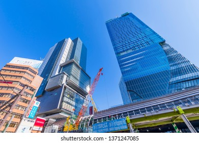 """SHIBUYA, TOKYO / JAPAN - APRIL 3 2019 : Scenery in front of """"Shibuya Station"""". A new landmark, the high-rise building """"SHIBUYA SCRAMBLE SQUARE"""", is scheduled to open in November 2019."""