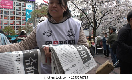 """SHIBUYA,  TOKYO,  JAPAN - CIRCA APRIL 1st 2019 : """"REIWA"""" becomes the new name, for a new era, under a new Emperor.  People try to receive a copy of Asahi newspaper reporting the name of new era."""