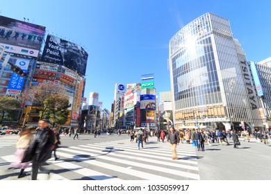 Shibuya, Tokyo, Japan - February 7, 2018: Shibuya pedestrian scramble: One of the world's most heavily used pedestrian scrambles at Hachiko Square in Shibuya, Tokyo.