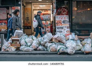 Shibuya, Tokyo / Japan - January - 1st - 2019:  garbage bags at the street close to shibuya district, the famous shopping area in new year day