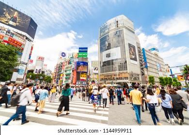 Shibuya, Tokyo, Japan - June 13, 2018: Shibuya pedestrian scramble: One of the world's most heavily used pedestrian scrambles at Hachiko Square in Shibuya, Tokyo.