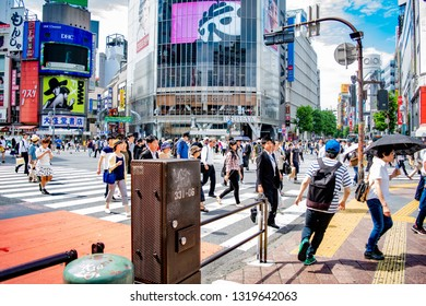 Shibuya, Tokyo, Japan - June 17 2016 - A much familiar and well known crossing, the Shibuya crossing is always packed with pedestrians going about their way, and the occasional tourist.