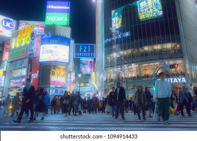 Shibuya, Tokyo, Japan - May 10th  2018: Crowd of people on famous tourist destination Shibuya crossing in Tokyo at night.