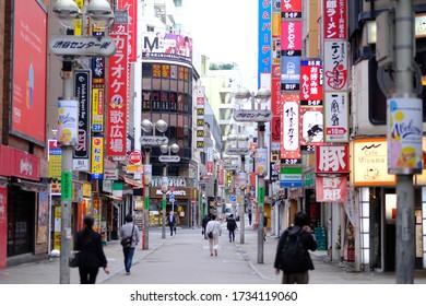 Shibuya, Tokyo, Japan - May 18 2020: Shibuya at 8:45 am. Wide shot with pedestrians.
