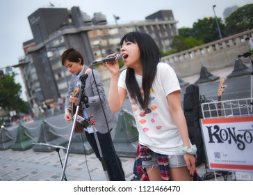 Shibuya, Tokyo / Japan - May 1st 2016: In front of the Meiji-Jingu Shrine and close from the Harajuku Station, two musician from the band called Konsome play Japanese Pop music in the streets.