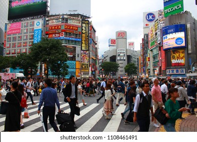 SHIBUYA, TOKYO, JAPAN - May 30th, 2018: View of the Shibuya crossing with lots of pedestrians. The Shibuya scramble crossing is one of the busiest crosswalks in the world.