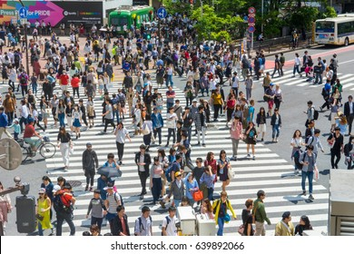 SHIBUYA - TOKYO, JAPAN - MAY 6, 2017: Pedestrians cross at Shibuya Crossing. It is one of the world's most famous scramble crosswalks.
