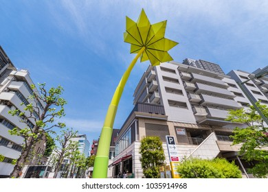 """SHIBUYA, TOKYO / JAPAN - MAY 8 2017 : """"Daikanyama"""" has a unique art called """"electric sunflower"""". Solar power generation is carried out with solar panels, and it glows brightly at night."""