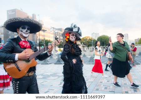 Shibuya, Tokyo / Japan - November 2nd 2017 : Day of the Dead (Día de Muertos) is celebrated by Mexican diaspora in Tokyo, here in the Harajuku district near the Meiji-Jingu Shrine.
