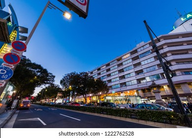"""SHIBUYA, TOKYO / JAPAN - OCTOBER 21 2018 : Night view of """"Omotesando"""" street. There are fashion building conscious trends such as """"La Foret Harajuku"""" and """"Tokyu plaza"""", and many people visit."""
