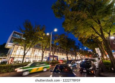 "SHIBUYA, TOKYO / JAPAN - OCTOBER 21 2018 : Night view of ""Omotesando"" street. There are luxury brand shops, etc. ""Omotesando Hills"", many people visit."