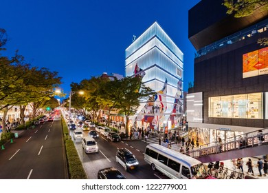 """SHIBUYA, TOKYO / JAPAN - OCTOBER 21 2018 : Night view of """"Omotesando"""" street. There are cafés and luxury brand shops on the street, many people visit."""