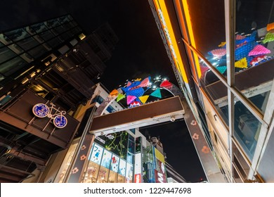 """SHIBUYA, TOKYO / JAPAN - OCTOBER 25 2018 : Scenery of """"Takeshita street"""" in Harajuku. There is a gate at the entrance of the street."""