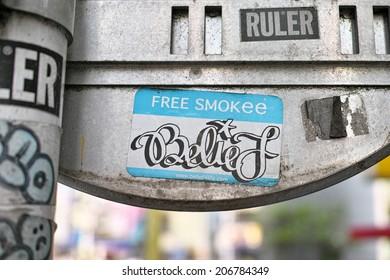 SHIBUYA, TOKYO - JULY 14, 2014: Artistic sticker graffiti or street art in Shibuya area, downtown Tokyo, Japan.
