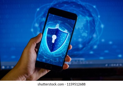 Shield Internet phone Smartphone is protected from hacker attacks, Firewall Businesspeople press the protected phone on the internet. space put message