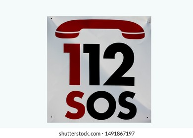 Shield with the text SOS 112