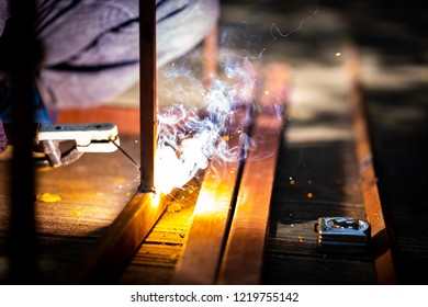 Shielded metal arc welding concept, welding iron flame building structure in metalwork. It is fabrication or sculptural process that joins materials. Using high heat to melt the parts together.