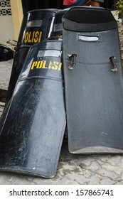 shields and batons guard riot police