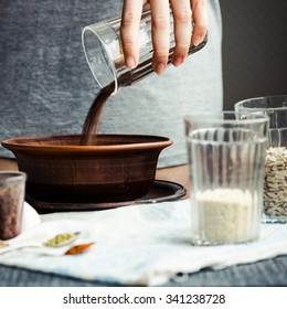 to shift from a glass in a plate of flax seeds for cooking crackers, hands