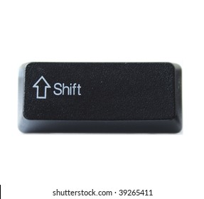 The Shift key from a black computer keyboard