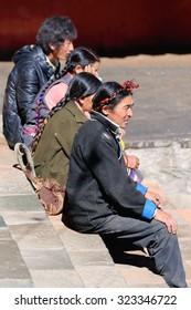 SHIGATSE, TIBET, CHINA-OCTOBER 24: Devotee family takes a break while visiting Tashilhunpo-Heap of Glory monast.-seat of Panchen Lama on October 24, 2012. Shigatse-Yarlung Tsangpo and Nyang Chu-Tibet.