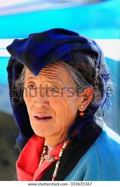 SHIGATSE, TIBET, CHINA-OCTOBER 24: Tibetan dealer woman prepares hair trimmings in a market on the street around the Tashilhunpo-Heap of Glory monastery-seat of Panchen Lama. Shigatse-Tibet.