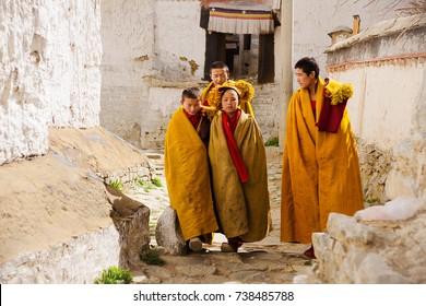 Shigatse, Tibet - May 06,2012: Young tibetan monks at Shigatse monastery, XVII century, a fortress and Buddhist monastery of Gelugpa school, Shigatse city, Tibet, China.