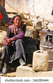SHIGATSE, TIBET-NOVEMBER 16: beautiful lady collecting water at a public tab. This is a very popular scene in the Shigatse city life. November 16, 2004 Shigatse, Tibet