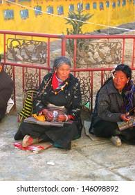 SHIGATSE, TIBET-NOVEMBER 16: old ladies praying inside Tashilhumpo  monastery. Founded in 1447 it is one of the most important monastery in Tibet. November 16, 2004 Shigatse, Tibet