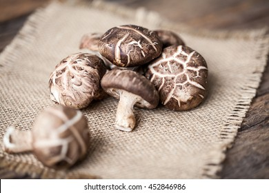 Shiitake mushroom on sackcloth and wooden background
