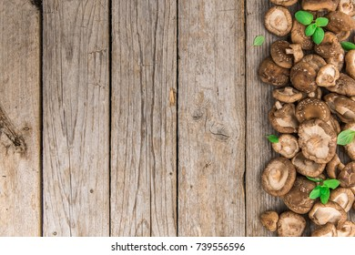 Shiitake mushrooms on a vintage background as detailed close-up shot, selective focus
