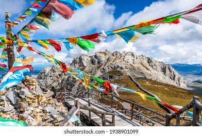 Shika snow mountain summit and Tibetan Buddhist prayer flags view in Shangri-La Yunnan China