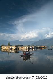 Shikaras and houseboats at Dal lake, Srinagar, Jammu and Kashmir, northern India