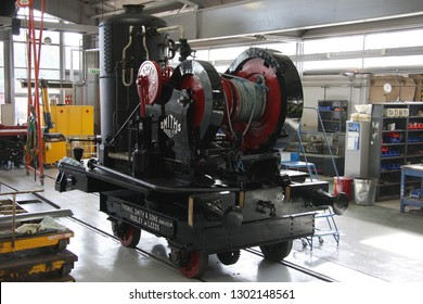 SHILDON, COUNTY DURHAM, UK - OCTOBER 8, 2012: Thomas Smith & Sons (Rodley) Ltd. Locomotive mounted steam crane, circa 1915, stands in the workshop undergoing restoration, at NRM 'Locomotion' Shildon.