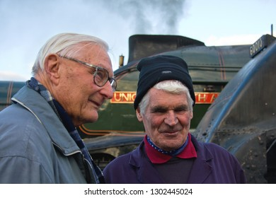 SHILDON, COUNTY DURHAM, UK - OCTOBER 20, 2012: John Cameron, owner of LNER Class A4 Pacific No. 60009 'Union of South Africa' stands with Peter Townend, former Assistant Motive Power Superintendent.