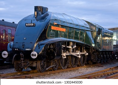 SHILDON, COUNTY DURHAM, UK - OCTOBER 20, 2012: As the sun begins to set the fine detail of LNER Class A4 Pacific No. 60008 'Dwight D. Eisenhower is accentuated by the surrounding lights at NRM Shildon