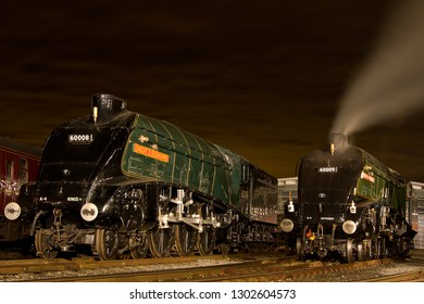 SHILDON, COUNTY DURHAM, UK - OCTOBER 20, 2012: A night time lineup of LNER A4 Pacific's at the NRM Shildon, with Nos. 60008 'Dwight D. Eisenhower' and 60009 'Union of South Africa' together again.