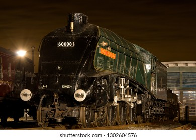 SHILDON, COUNTY DURHAM, UK - OCTOBER 20, 2012: At night the fine detail of LNER Class A4 Pacific No. 60008 'Dwight D. Eisenhower is accentuated by the surrounding lights at the NRM Locomotion Shildon.
