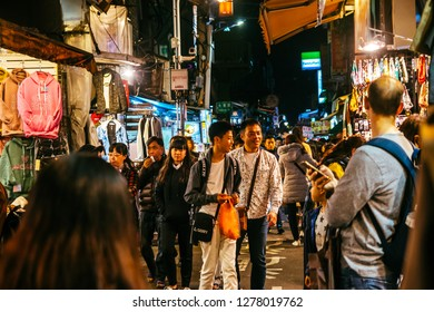 Shilin Night Market, Taipei, Taiwan, Republic of China - December 23, 2018 :  Visitors wander the sidestreets