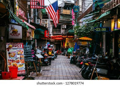 Shilin Night Market, Taipei, Taiwan, Republic of China - December 23, 2018 :  Side streets of the markets, Huge Burger