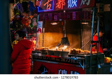 Shilin Night Market, Taipei, Taiwan, Republic of China - December 23, 2018 :  Out the front of the Night Market entrance at night.